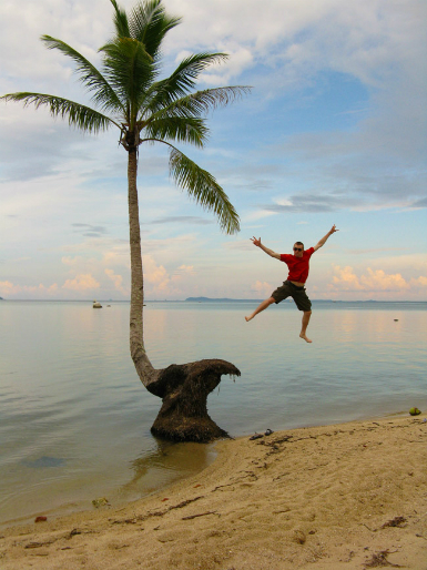 "Andrew Marston doing a ""palm jump"" in Indonesia (supplied)."